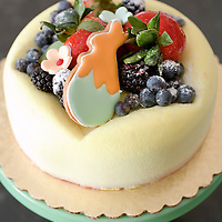 cake for Easter with fresh fruit and rabbit cookie
