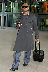 MAR 12 2014 Seal arrives at Heathrow Airport from Los Angeles
