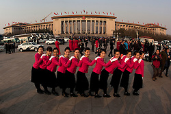 Stewardesses pose for photos outside the Great Hall of the People (GHOP) during the opening session of the National Peoples Congress (NPC) at the Great Hall of the People in Beijing, China, on 05 March 2011. The NPC has over 3,000 delegates and is the world's largest parliament or legislative assembly though its function is largely as a formal seal of approval for the policies fixed by the leaders of the Chinese Communist Party.