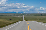 US Route 89 in the Great Plains of Montana with the Rocky Mountains on the horizon