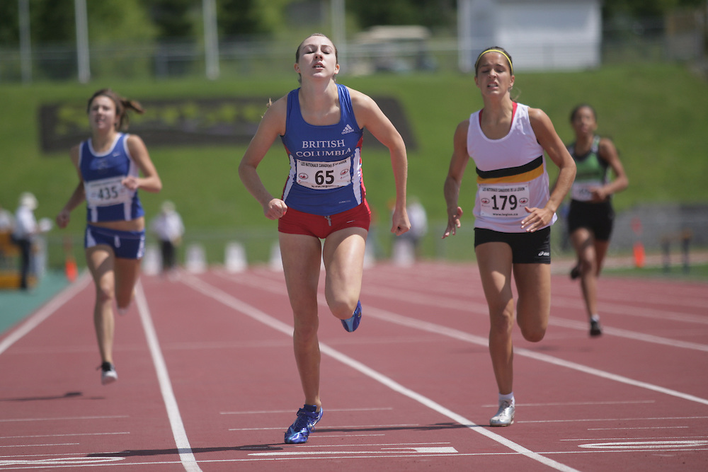 (Sherbrooke, Quebec -- 8 Aug 2009)  Katie Reid of British Columbia (65),  Brittany Lewis of Sarnia Athletics Southwes (435);  Carly Paracholski of Manitoba (179)\ competes in 400m final at the 2009 Royal Canadian Legion National Youth track and field championships. Photograph copyright Sean Burges / Mundo Sport Images  2009.