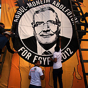 Egyptian youth volunteers work on a large mural in support of Islamist Presidential candidate Abdul Moneim Aboul Fotouh at an April 30, 2012 campaign rally in Alexandria, Egypt.