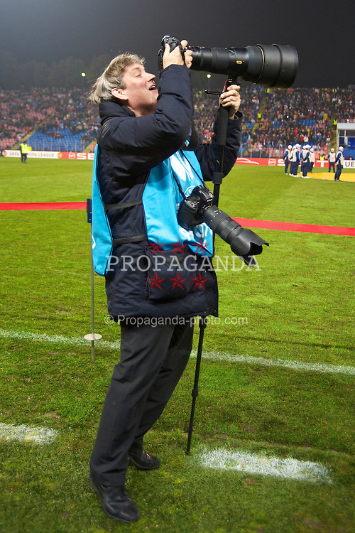BUCHAREST, ROMANIA - Thursday, February 25, 2010: Getty Images photographer John Powell during the UEFA Europa League Round of 32 2nd Leg match at the Steaua Stadium. (Photo by David Rawcliffe/Propaganda)