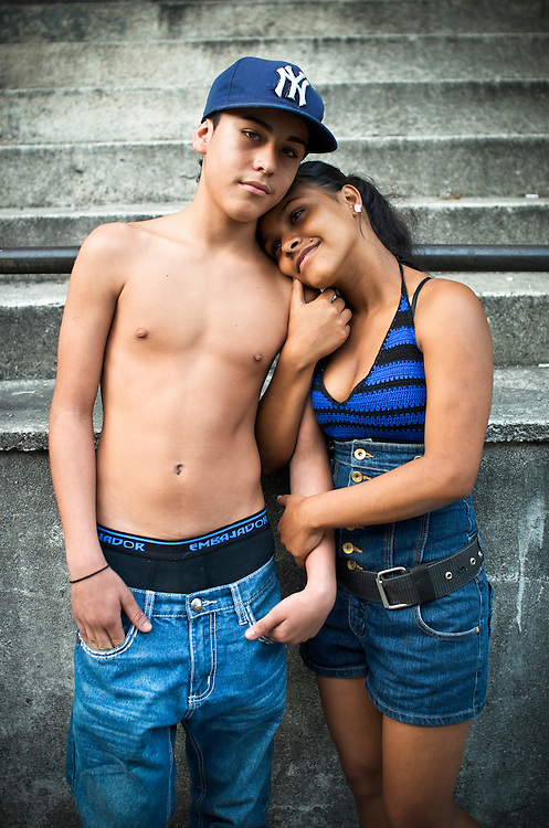 Teenage parents, Diovile Toro, 18, and her boyfriend, Gilberto Marquez, 16, pose for a portrait in a slum in Caracas, Venezuela. Toro and Marquez live together with their 5-month-old daughter, Diovelys.