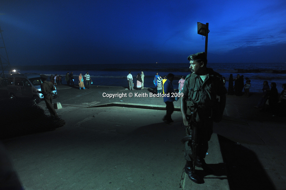 Member of Sri Lanka's security forcers patrols in Colombo, Sri Lanka, July 5, 2009. With the end of the 26 war between the Sri Lankan government and the LTTE, security in the capital city remains on high alert.