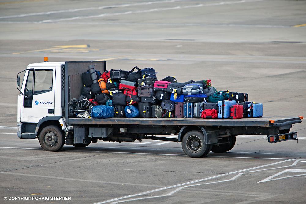 Servisair truck transferring baggage at airport