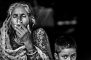 A grandmother and her young charge in a Rajasthani nomadic camp in Manali, India.