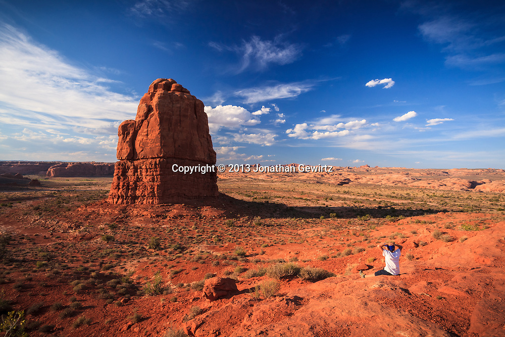 A young visitor takes in the dramatic rock formations of Arches National Park, Utah. WATERMARKS WILL NOT APPEAR ON PRINTS OR LICENSED IMAGES.<br /> <br /> Licensing: https://tandemstock.com/assets/96771975