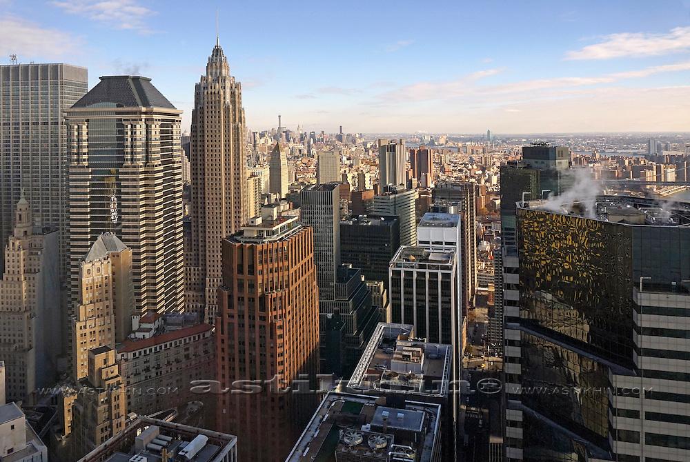 Skyscrapers in Lower Manhattan against blue sky.