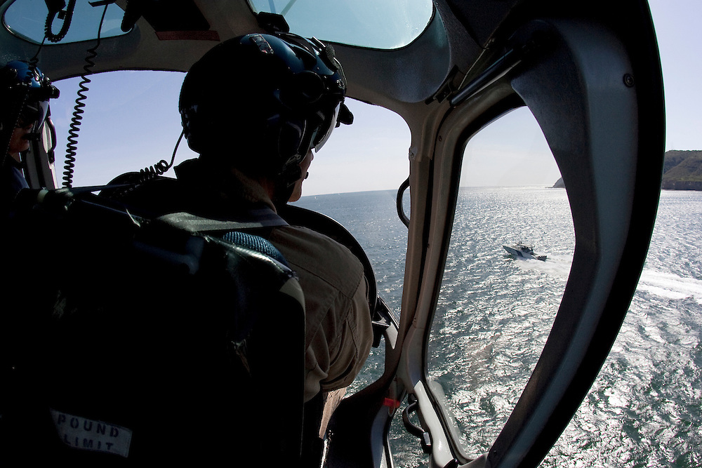 "Adam Polak, Customs and Border Protection agent with the Air and Marine division, patrols the shoreline along the U.S/Mexico border in San Diego, California. For more images, search for ""immigration by air and sea"". Please contact Todd Bigelow directly with your licensing requests. PLEASE CONTACT TODD BIGELOW DIRECTLY WITH YOUR LICENSING REQUEST. THANK YOU!"