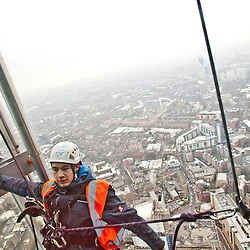 London, UK - 23 January 2013: the picture shows a window cleaner and the view of London as seen from 'The View from the Shard'.  'The View from the Shard' opens to the general public on the 1st of February, offering an unrivalled view on the city of London.