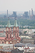 Cathedral of the Divine Saviour in front of Blast furnaces of Vítkovice Iron and Steel Works, Ostrava, Czech Republic ...Cathedral of the Divine Saviour (Czech: Katedrála Bo?ského Spasitele), located in the center of Ostrava, is the second largest Roman Catholic cathedral in Moravia and Silesia (after the basilica in Velehradnear Uherské Hradi?t?). This three-nave neorenaissance basilica with a semi-circular apse and two 67m high towers is dating since 1889 (building started in 1883). The church was designed by Gustav Meretta, the official architect of the Archbishop of Olomouc, and the interior by Max von Ferstel.