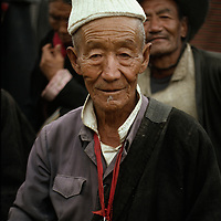 A tibetan man with a picture of the Dalai Lama, Lhasa, Tibet, 1990