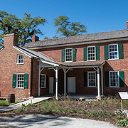 Built in 1823 from bricks made and fired on site, the preserved Federal-style home of William Conner is now listed on the National Register of Historic Places. William Conner (1777-1855) was a fur trader, farmer, land speculator, miller, merchant and politician. Conner Prairie Interactive History Park provides family-friendly fun for all ages in Fishers, Indiana, USA. Founded by pharmaceutical executive Eli Lilly in the 1930s, Conner Prairie living history museum now recreates life in Indiana in the 1800s on the White River.