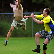 Craig Modisher leaps but just misses the pickoff from Chuck Hayward during practice of the Skin n' Bones ultimate frisbee team.