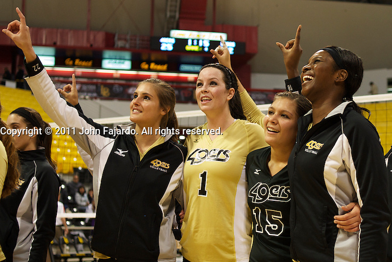 Seniors Jocelyn Neely, Lauren Minkel, Michelle Osunbor and Caitlin Ledoux after the match against New Mexico at the Walther Pyramid, Long Beach, Calif., Sat., Nov. 26, 2011.