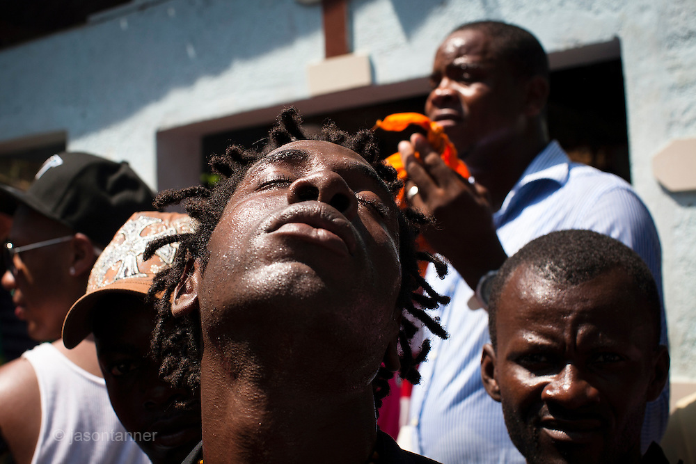 Dominican Republic: A musician in trance performs to locals in the town of Haina as part of the GaGá  procession of El GaGá de San Luis....