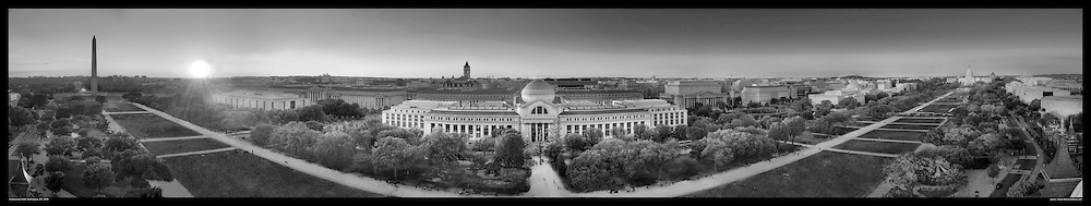 Panoramic photo of Smithsonian Mall as seen from atop the Smithsonian Castle.  The Smithsonian Museum of Natural History is shown in center with The Washington Monument and US Capitol at each end. Print Sizes (in inches):15x3; 24x4.5; 36x7; 48x9; 60x11; 72x13.5.