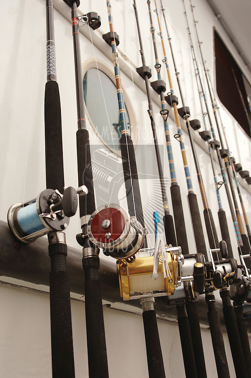 Deep Sea fishing poles lined up on the side of a sport fishing boat