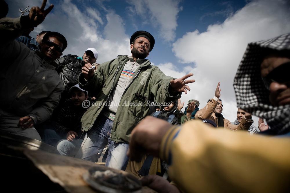 LIBYA. BENGHAZI. Anti-Kadhafi demostrators dance in the center of Benghazi on February 26, 2011. ALESSIO ROMENZI