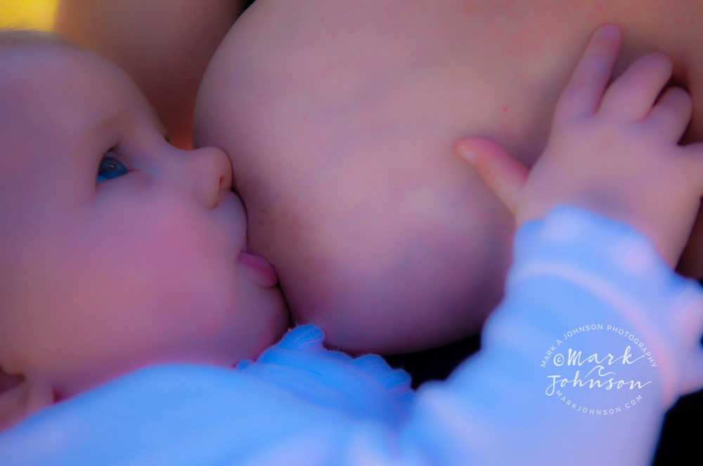 Mother breastfeeding 2 month old baby girl