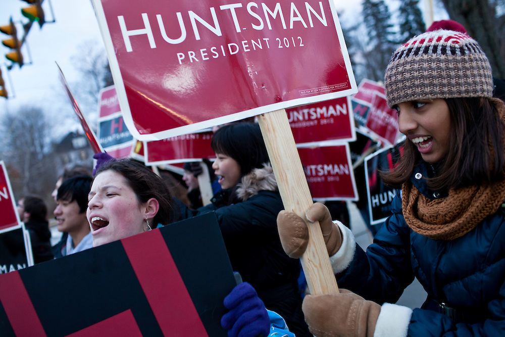 Emma Badner, left, and Tara Ready, from Mamaroneck High School in Mamaroneck, New York, march down Elm Street in support of Republican presidential candidate Jon Huntsman on Sunday, January 8, 2012 in Manchester, NH. The students were on a field trip as part of an AP Government class. Brendan Hoffman for the New York Times