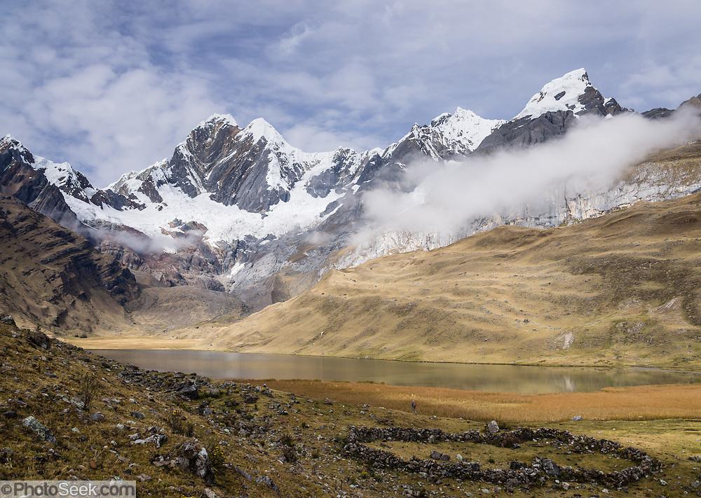 "Mitucocha lake (4270 m), Nevado Jirishanca (left, ""Icy Beak of the Hummingbird"" 6094 m), Rondoy (right 5870 m). Day 2 of 9 days trekking around the Cordillera Huayhuash in the Andes Mountains, Peru, South America."