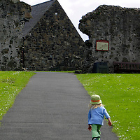 Europe, Ireland, Northern Ireland, Bushmills. Child at Dunluce Castle.