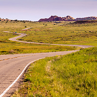 A paved road winds through high desert meadows of Canyonlands National Park, Utah. WATERMARKS WILL NOT APPEAR ON PRINTS OR LICENSED IMAGES.