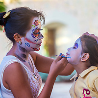 OAXACA , MEXICO - NOV 02 : Unidentified participant has his face covered with makeup on a carnival of the Day of the Dead in Oaxaca, Mexico on November 02 2015.