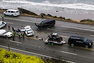 The Los Angeles Coroner is assisted by law enforcement officers to remove the body of a victim of a car crash involving one person was killed and at least seven other people were injured, in a chain reaction, head-on crash in Malibu Calif. on Saturday 7, 2015. The SUV with a trailer is belong to Reality-TV star Bruce Jenner.