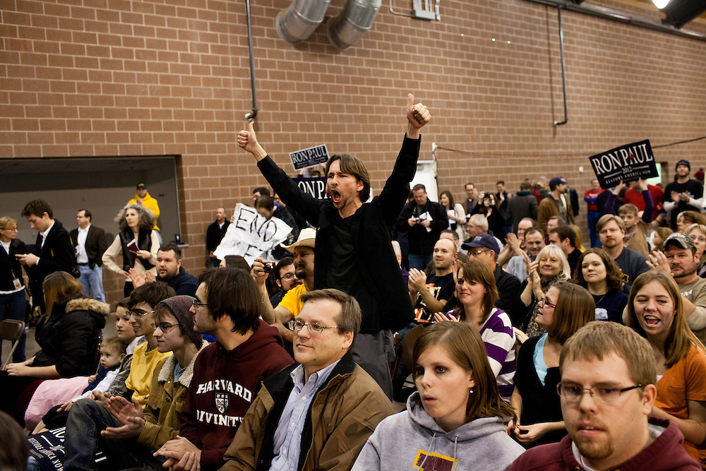 A man shouts in support as Republican presidential candidate Ron Paul speaks at a Salute to Veterans Rally on Wednesday, December 28, 2011 in Des Moines, IA.
