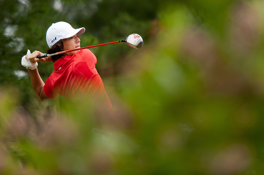 RYO ISHIKAWA hits his tee shot on the 16th hole at Congressional Country Club during the first round of the U.S. Open in Bethesda, MD.