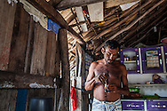 Aldemir Brito, 39, drinks coffee early in the morning in his house at Queimada dos Britos.  In this small oasis around 60 people live in, but the locals are not sure, since there is always someone going away or coming back. No one really knows when the village was founded but the legend says that the founder Manuel Brito, when running away from home due to a drought that was scorching his homeland, he ended up settling down in the only non-sandy portion of the Lençois.