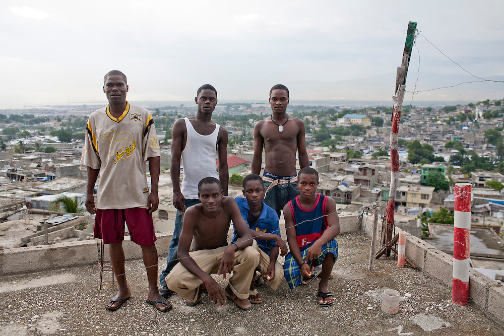 Men pose for a picture on a rooftop on July 13, 2010 in the Fort National neighborhood in Port-au-Prince, Haiti.