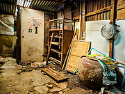 16 MAY 2017 - BANGKOK, THAILAND: Interior of an abandoned home in Pom Mahakan. Bangkok city officials are expected to tear the structure down in coming weeks. The final evictions of the remaining families in Pom Mahakan, a slum community in a 19th century fort in Bangkok, have started. City officials are moving the residents out of the fort. NGOs and historic preservation organizations protested the city's action but city officials did not relent and started evicting the remaining families in early March.           PHOTO BY JACK KURTZ