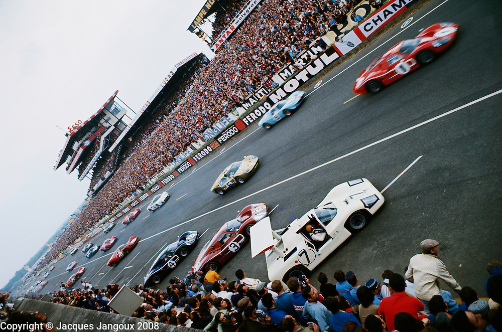Start of Le Mans 24 hour race in 1967:  race was won by Dan Gurney and A. J. Foyt on their Ford GT 40 Mk IV red car No 1 at top right; white Chaparral driven by Mike Spence in foreground.