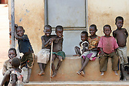 October 7, 2006 - Children sit around a community building at Tetugu camp for internally displaced people, or IDP, near Gulu in north Uganda. Tetugu, with a population of 22,000, is one of 76 IDP camps around Gulu, the main base for the Uganda Peoples Defense Force fighting the insurgent Joseph Kony's Lord's Resistance Army. Kony's LRA movement has been fighting for the past 20 years to force the East African country to be ruled according to the Christian Ten Commandments. Over 2 million people, mostly of the Acholi tribe, have moved or were forced to move from their villages to camps close to the towns of Gulu, Lira, and Kitgum where they are watched over by the Ugandan Army. The LRA rebels have abducted thousands of children and have forced them to fight against the Ugandan Army and the Acholi people. Current peace talks between Kony's LRA and the Ugandan government held in Juba, southern Sudan, offer a glimpse of hope to ending this ongoing conflict..(Photo by Jakub Mosur/Polaris)<br />