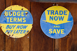 two retro signs from a car dealership