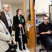 03/11/2011 - Boston, Mass. - Postdoctoral Associate, Tarek Deeb, speaks to parents during their tour of laboratories at the Tufts University School of Medicine's Biomedical Research and Public Health Building on Friday, March 11, 2011. (Emily Zilm for Tufts University)
