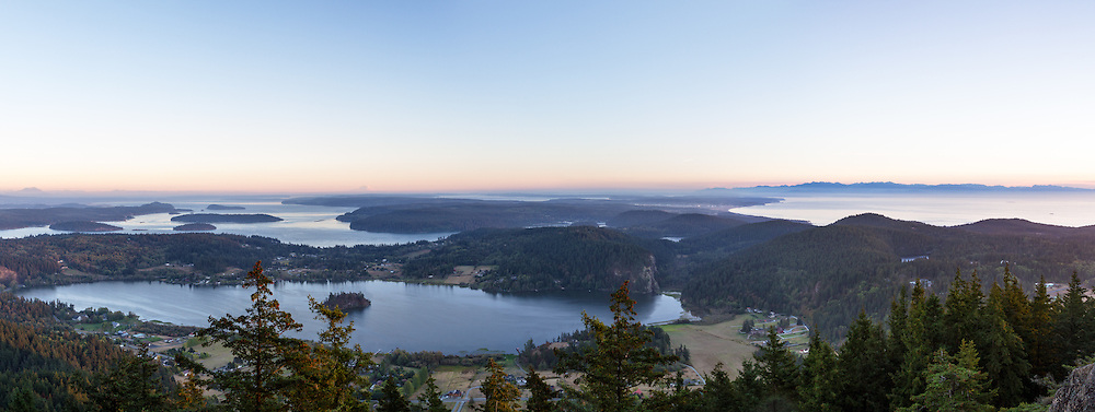View looking south from Mt. Erie on Fidalgo Island, Washington State, USA.  Lake Campbell is in the foreground, with Similk Bay, Whidbey Island, and the Olympic Mountains (right) in the background.  Photographed from Mt. Erie Park in Anacortes, Washington.