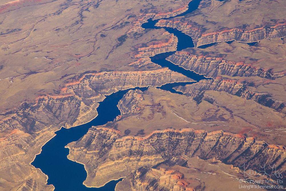 Bighorn Lake and Bighorn Canyon, part of the Bighorn Canyon National Recreation Area, are visible in this aerial view captured southwest of Yellowtail, Montana. Bighorn Lake is a reservoir formed by Yellowtail Dam, which was finished in 1965. When the reservoir is full, the lake extends 72 miles (115 kilometers) — the entire length of Bighorn Canyon — into Wyoming.