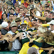 Green Bay's Donald Driver celebrates his touchdown with a Lambeau Leap in the 2nd quarter.  The Green Bay Packers hosted the San Diego Chargers in their first pre-season game at Lambeau Field Thursday August 11, 2005. Steve Apps-State Journal.