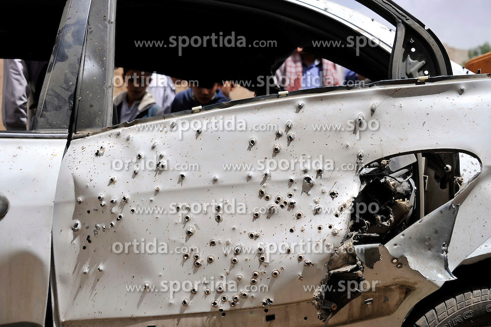 A damaged car is seen at the blast site in Sanaa, Yemen, on March 21, 2015. The Islamic State (IS) carried out a series of suicide bombing attacks in Sanaa and the northern Saada province that have killed at least 154 people and wounded 350 others. EXPA Pictures &copy; 2015, PhotoCredit: EXPA/ Photoshot/ Hani Ali<br /> <br /> *****ATTENTION - for AUT, SLO, CRO, SRB, BIH, MAZ only*****