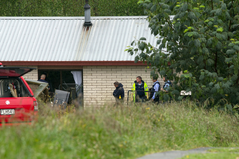 Police and AOS arrested a man after negoitating for an hour when he locked himself in a house with some knives, Greerton, Tauranga, New Zealand, Monday, November 03, 2014. Credit:SNPA / Cameron Avery