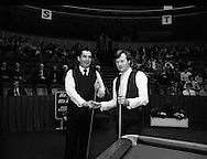 The Benson and Hedges .Irish Masters Snooker..1984..28.03.1984..03.28.1984..28th March 1984..The championship was held at Goffs,Co Kildare. All the top names in snooker took part..Steve Davis,Jimmy White,Eddie Charlton,.Tony Knowles,Dennis Taylor,Tony Meo,.Alex Higgins,Ray Reardon,.Cliff Thorburn,Terry Griffiths,.Bill Werbeniuk and Eugene Hughes..The eventual winner was Steve Davis who beat Terry Griffiths 9 -1 in the final..Image taken as Ray and Alex pose for the cameras..