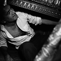 CRAWLING BENEATH THE TOMB OF A SAINT THREE TIMES BRINGS THE GYPSIES LUCK THEY BELIEVE, AT THE ANNUAL KALDERASH FESTIVAL, BISTRITA MONASTERY, COSTESTI, ROMANIA.SEPTEMBER 1994..©JEREMY SUTTON-HIBBERT 2000..TEL./FAX. +44-141-649-2912..TE. +44-7831-138817.