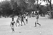 When they're not searching for food or water, boys of all ages at the St. Louis tent city in Port-au-Prince congregate to play soccer and basketball. Water is more widely available here than at other settlements in the city, with a large Doctors Without Borders camp located nearby.