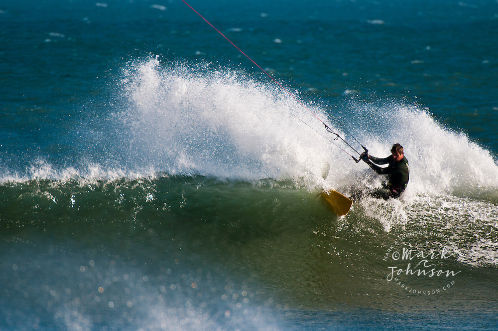 Jeff King shredding the lip while kitesurfing at Punto San Carlos, Baja California, Mexico