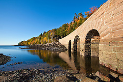 A triple-arch stone bridge on the Park Loop Road in Maine's Acadia National Park. Fall.
